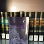 Cat Lady by Mary M. Schmidt in an Italian Library